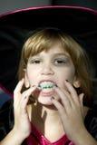 Pequeña muchacha enojada linda en la suposición del carnaval Imagen de archivo libre de regalías