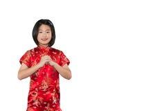 Pequeña muchacha oriental que le desea un isolat chino feliz del Año Nuevo Foto de archivo