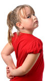 Pequeña muchacha que mira sobre el hombro aislado en blanco Foto de archivo