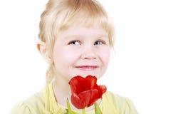 Pequeña muchacha rubia con el tulipán Imagen de archivo libre de regalías