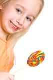 Pequeña muchacha rubia con un caramelo Fotos de archivo libres de regalías