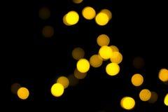 Pequeña noche de BOKEH, la NAVIDAD del AMARILLO de BOKEH Imagenes de archivo