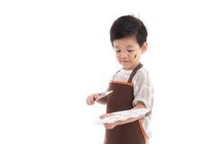 Pequeña pintura asiática linda del muchacho aislada imagenes de archivo