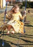 Pequeña princesa en un oscilación Fotos de archivo
