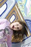 Pequeña risa de la muchacha Foto de archivo