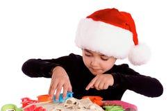 Pequeña Santa Cooking Imagenes de archivo