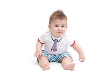 Pequeña sentada del bebé Imagen de archivo libre de regalías