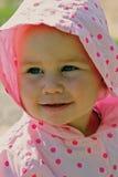 Pequeña sonrisa del bebé imagenes de archivo