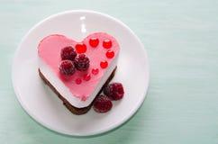Pequeña torta agradable bajo la forma de corazón Fotografía de archivo