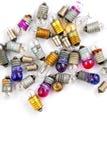Pequeñas bombillas coloreadas viejas en un fondo blanco Fotografía de archivo libre de regalías