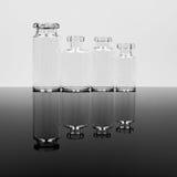 Pequeñas botellas de cristal Imagen de archivo