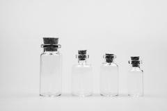 Pequeñas botellas de cristal Imagen de archivo libre de regalías