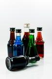 Pequeñas botellas del alcohol colorido Imágenes de archivo libres de regalías