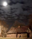 Pequeñas casa y luna de madera Fotos de archivo libres de regalías