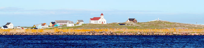 Pequeñas casas en el mar Imagen de archivo
