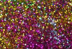 Pequeñas lentejuelas multicoloras como fondo Imagenes de archivo