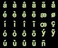 Pequeñas letras fosforescentes con signos diacríticos Fotos de archivo