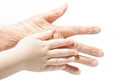 Pequeñas manos y manos grandes Imágenes de archivo libres de regalías