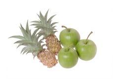 Pequeñas manzana y piña Foto de archivo