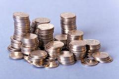 Pequeñas monedas de plata Foto de archivo