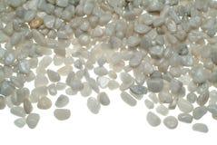 Pequeñas piedras blancas Imágenes de archivo libres de regalías