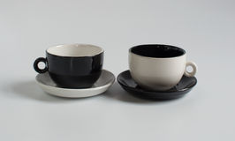 Pequeñas tazas blancos y negros Fotografía de archivo libre de regalías