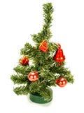 Pequeño árbol de navidad agradable con la decoración roja Imagen de archivo libre de regalías