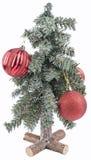 Pequeño árbol de navidad con la decoración Imagenes de archivo