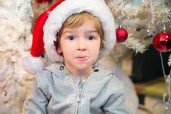 Pequeño ayudante sucio de Santas Imagen de archivo