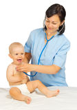 Pequeño bebé con el doctor fotografía de archivo libre de regalías