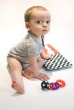 Pequeño bebé con los juguetes Fotografía de archivo