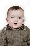 Pequeño bebé en el primer tomado blanco imagen de archivo