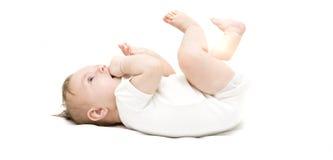 Pequeño bebé en un fondo blanco Imagen de archivo libre de regalías