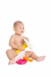 Pequeño bebé que juega los juguetes 4 Imágenes de archivo libres de regalías
