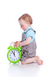 Pequeño boyl lindo con el reloj Imagen de archivo