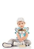 Pequeño campeón con su trofeo Imagenes de archivo