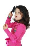 Pequeño cepillo lindo de la muchacha el pelo Imagen de archivo