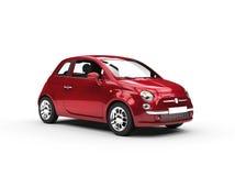 Pequeño Cherry Red Metallic Economy Car Imagen de archivo libre de regalías