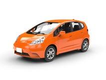 Pequeño coche compacto anaranjado moderno Fotografía de archivo libre de regalías