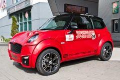 Pequeño coche rojo Foto de archivo libre de regalías