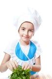 Pequeño cocinero feliz del cocinero con perejil Foto de archivo libre de regalías