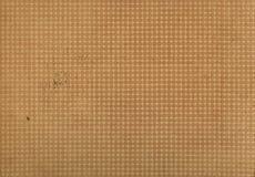Pequeño color crema del marrón del ornamento del fondo Imagen de archivo