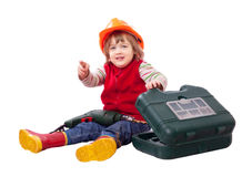 Pequeño constructor en el casco de protección con las herramientas Fotos de archivo libres de regalías