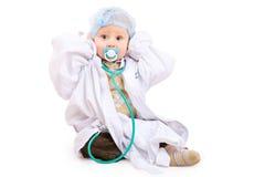 Pequeño doctor en el suelo Imagen de archivo