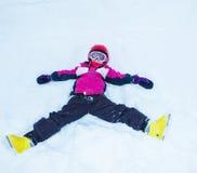 Pequeño esquiador juguetón Foto de archivo