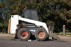 Pequeño excavador Bobcat Imagen de archivo libre de regalías