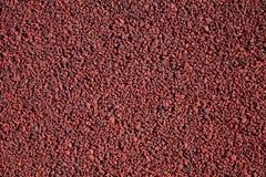 Pequeño fondo abstracto del rojo de las piedras Foto de archivo