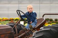 Pequeño granjero con la cara divertida Foto de archivo libre de regalías