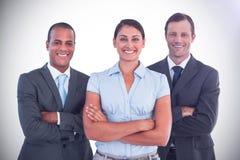 Pequeño grupo de hombres de negocios sonrientes que se unen Imágenes de archivo libres de regalías