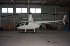Pequeño helicóptero en el hangar Imagen de archivo libre de regalías